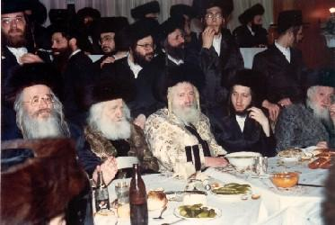 "The Rebbe zt""l on left with the Zutchke Rebbe zt""l and the Rebbe's mechuten the Kretchnif-Siget Rebbe zt""l in middle"